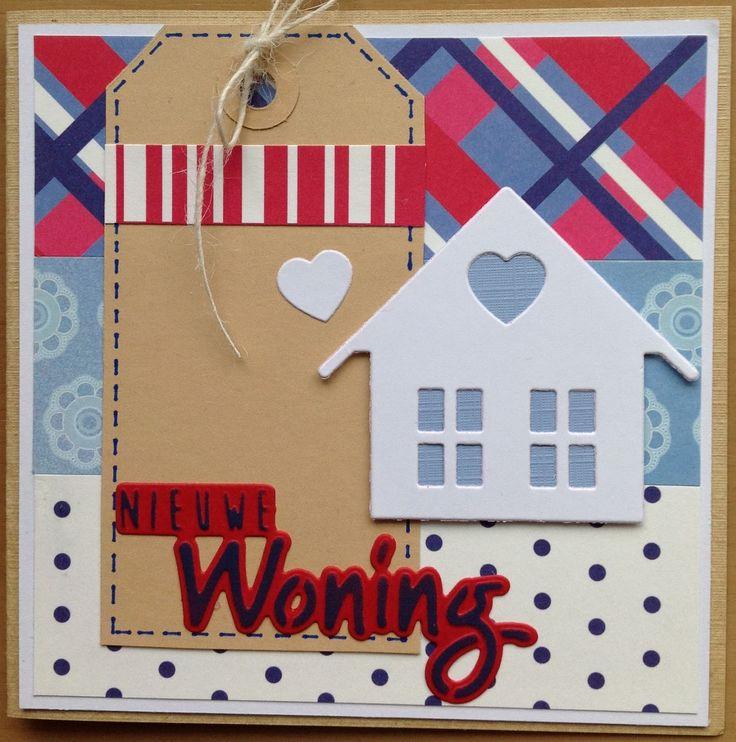 Ik pakte mijn papierblokje in Hollands thema er weer eens bij. Daarmee maakte ik dit verhuis-kaartje. Het huisje leende ik van mijn dochter...