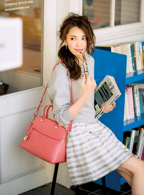 .Light gray sweater with gray striped skirt