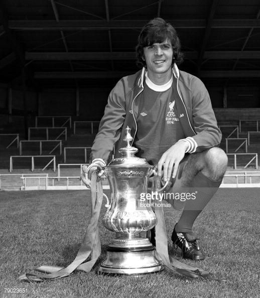 Sport Football England August 1974 Liverpool FC Photocall Liverpool FC's Peter Cormack is pictured with the FA Cup trophy that his side won against Newcastle United