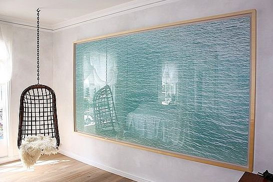 massive image of simple ocean waves makes a huge impression on a large, blank wall. #art
