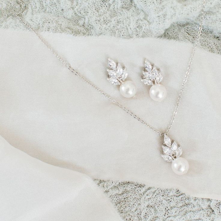 Bocheron pearl earrings by Stephanie Browne Wear these pearl drop earrings to add a flawless finish to a vintage-inspired bridal look.