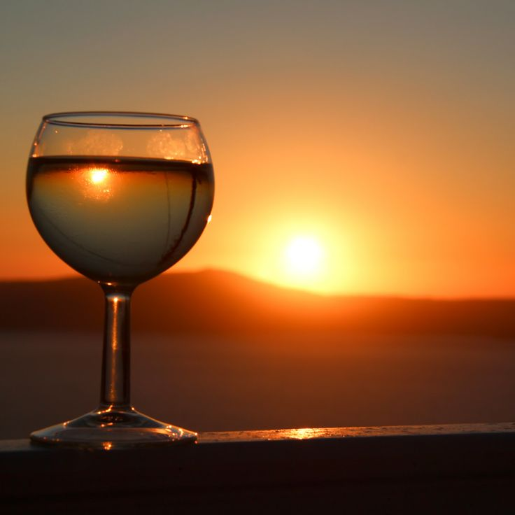 #Santorini's magical sunset is the ideal setting for the most romantic getaway you have ever experienced. Live it with a glass of #Vinsanto.