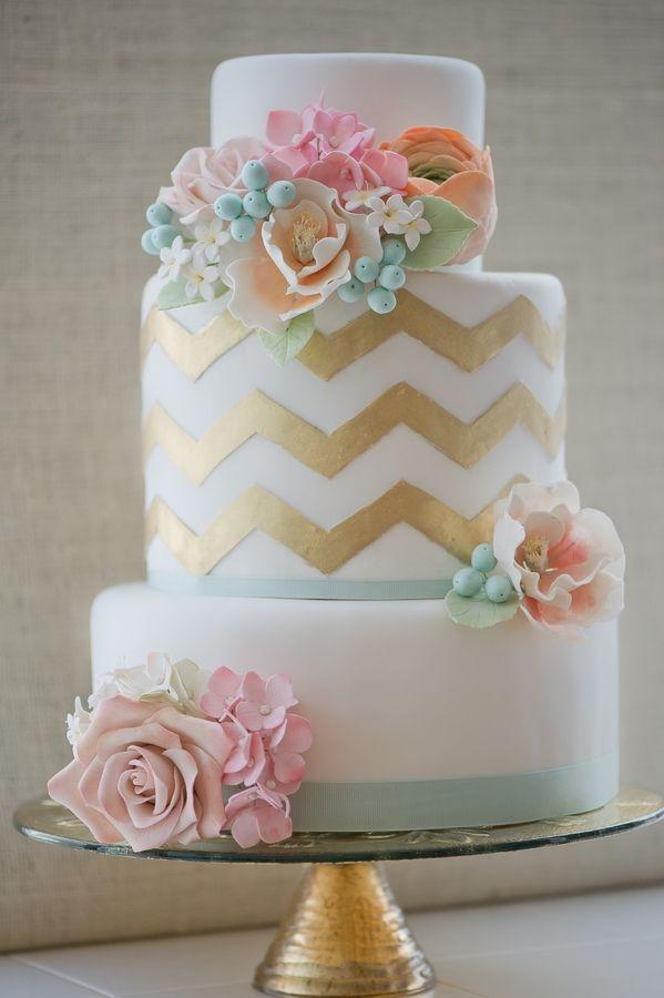 Three tier cake with hand-cut gold chevron, sugar roses, hydrangea, ranunculus, and jasmine