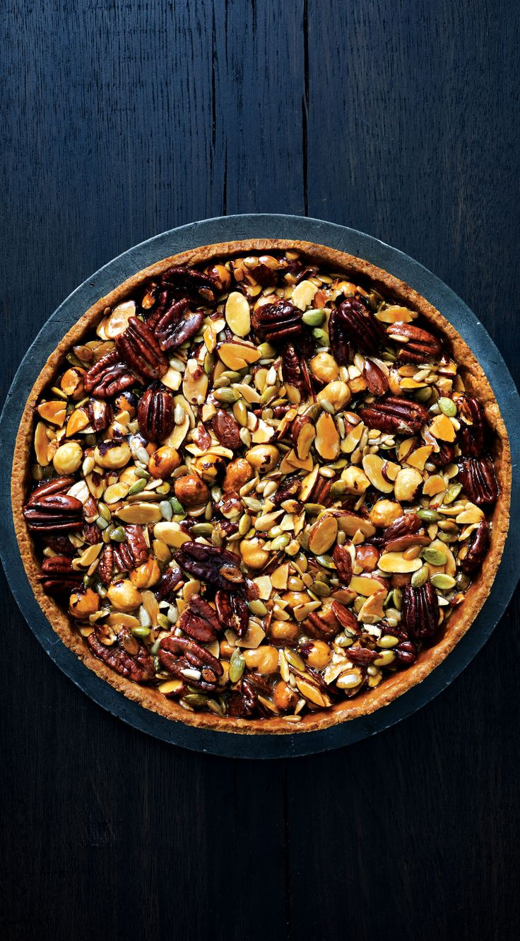 This caramelized-honey tart is packed with nuts and seeds for a (kinda) virtuous dessert.