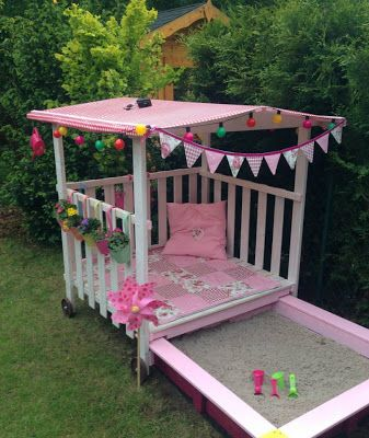Summer playhouse with a pullout sandpit - but not in pink!