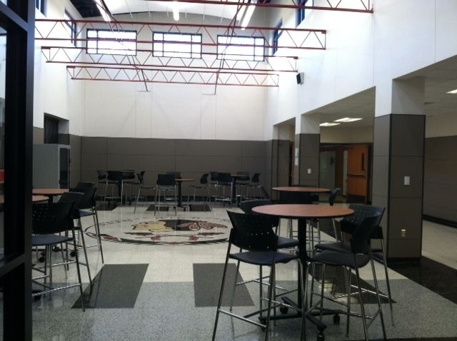 The lobby at Iraan High School in Iraan Texas, installed September 2013, features custom cut and custom color terrazzo tiles from Fritztile. A careful matching process ensured that the school color was duplicated accurately in the logo. #schoollogo #schoolflooring #customtile #terrazzo #fritztile