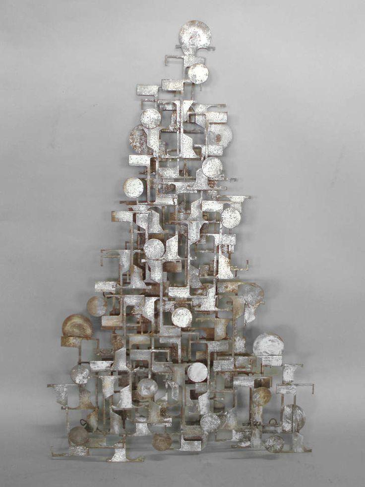 brutalist industrial wall sculpture