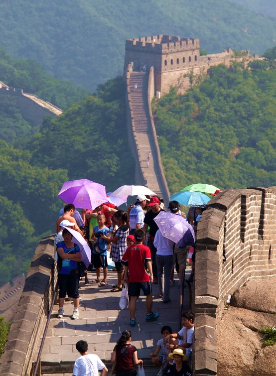 Colorful umbrellas shade visitors from the sun on the Great Wall at Badaling, north of Beijing.