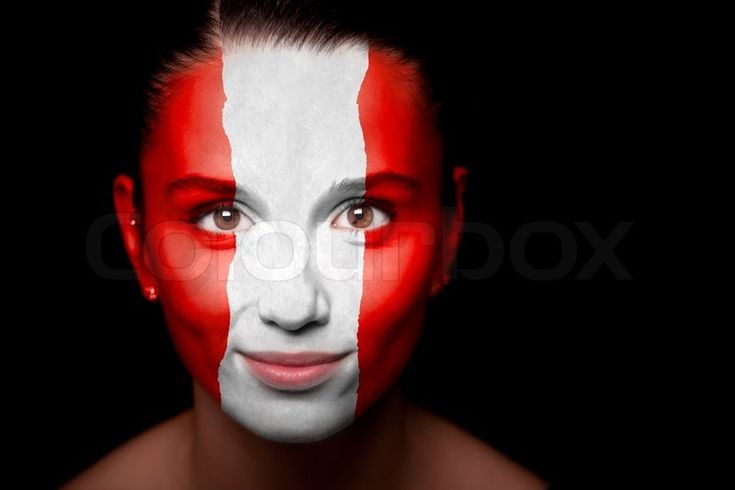 Stock image of 'Portrait of a woman with the flag of the Austria painted on her face'