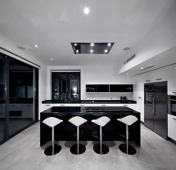 Modern black white kitchen in a lagos portugal residential home named colunata house