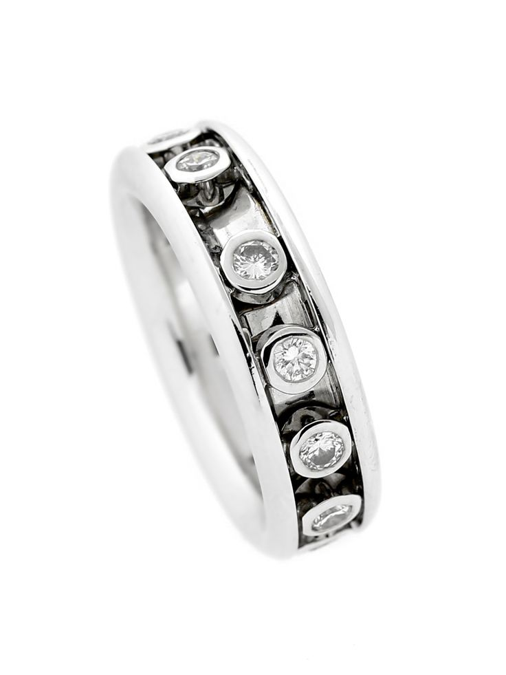 A fun, chic ring by Dior featuring round brilliant cut diamonds set in bezels freely floating throughout the band. This classically designed ring is sure show off your fun side with diamonds wrapping the entire length of the ring!