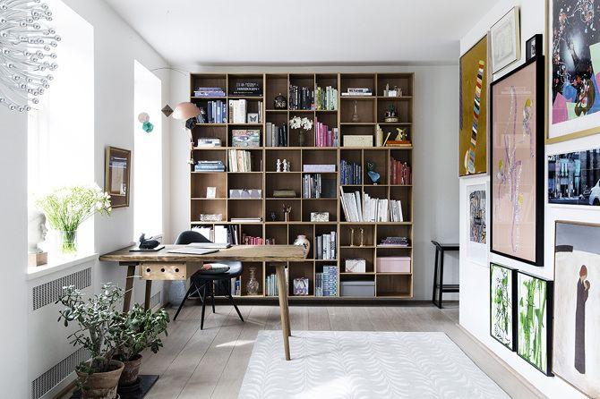 Mogens Koch bookshelf, Københavns Møbelsnedkeri table, Pink Inga Sempe lamp, rug by Rug Company and a gallery wall