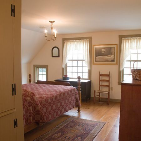 Upstairs Bedroom with Wide Pine Flooring and Custom Built-in Cabinet