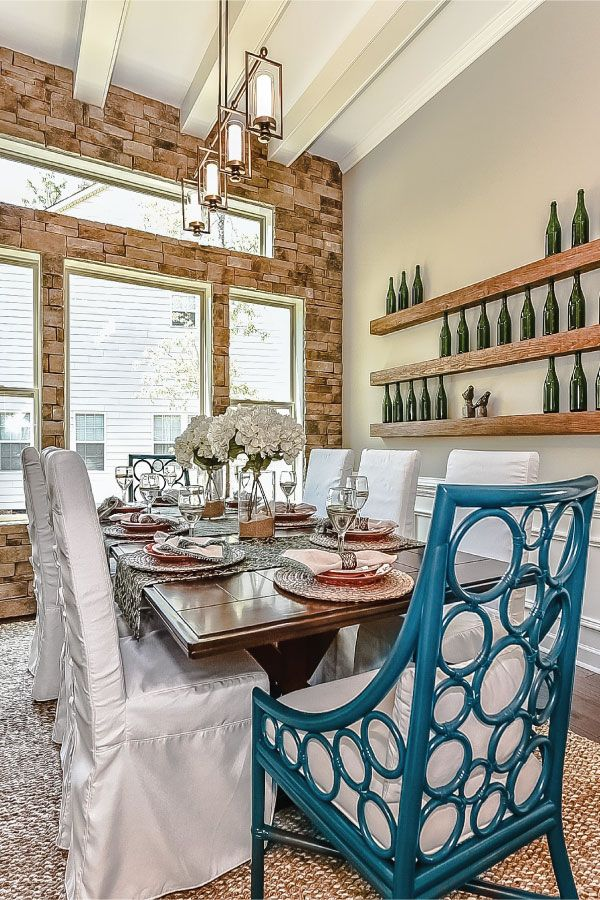 Beautiful stone accent wall in the dining room of our Redwood Model  Wine  bottle shelf. 49 best Our Model Homes in Charlotte NC and the Surrounding Area
