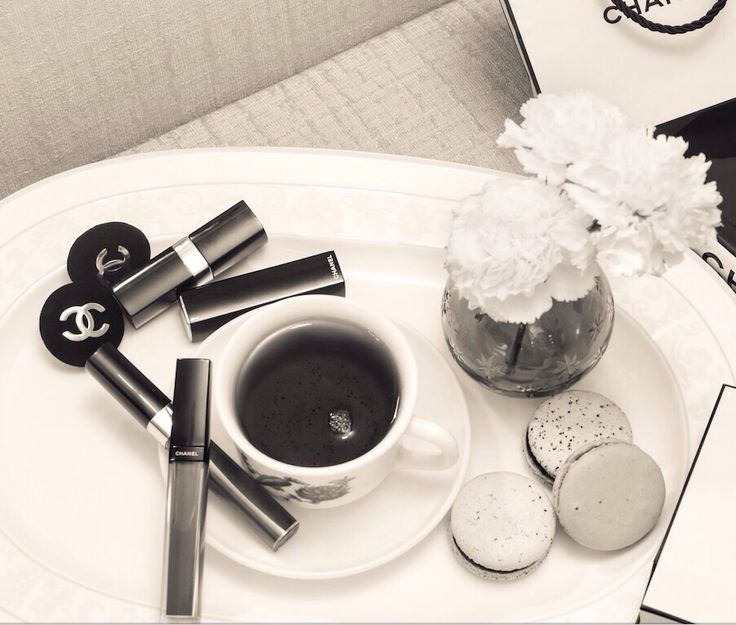 Coffee, macaroons and these vintage velvet Chanel black CC studs on our platter today! Yumm
