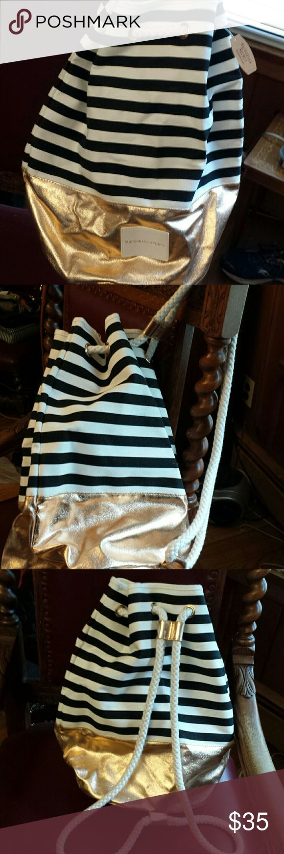 Victoria's Secret NWT Striped Backpack Victoria's Secret NWT Black and White Striped Backpack with gold bottom, Rope Cinch Tie, Good condition Bags Backpacks