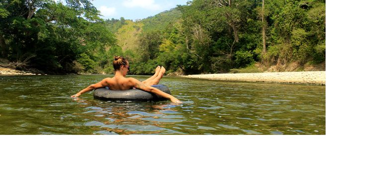 Tubing in Rio Palomino, Guajira. This cold and tranquil river which flows out into the Caribbean, is an ideal place to relax and let  troubles go away.