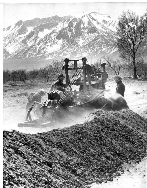 """Page 1 :: """"Laying Water Line For Japanese Boom Town"""" -- caption on photograph :: Japanese American Relocation Digital Archive, 1941-1946. http://digitallibrary.usc.edu/cdm/ref/collection/p15799coll75/id/1674"""