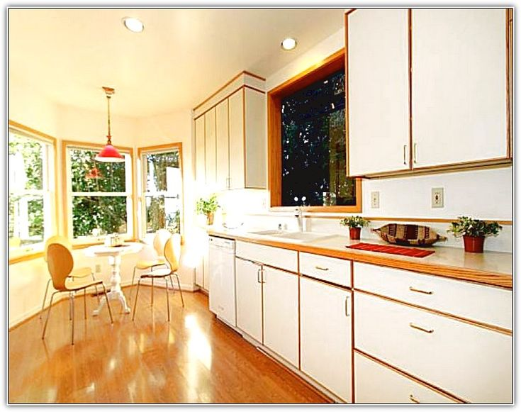 White Kitchen Cabinets With Stained Wood Trim