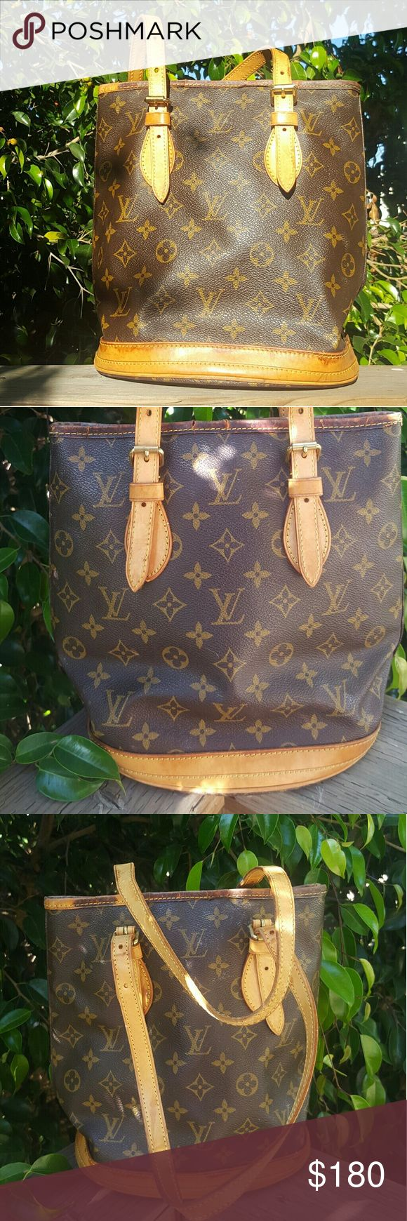 Authentic Louis Vuitton bucket pm bag Authentic Louis Vuitton bag canvases in good condition but some cracking on the edges an inside is all peeled off Louis Vuitton Bags