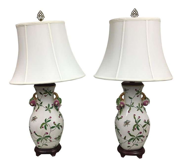 "Design Plus Consignment Gallery presents an elegant pair of table lamps. Delicate hand painting of flora and fauna decorate the raku ceramic finish. Brass finials, Pagoda Lampshades and Rosewood bases add a bit of Asian flair. Extra Measurements: Lamp Base: W7.5"" x D5.5"" x H31"" Shade: W16"" x D11"" x H12"""