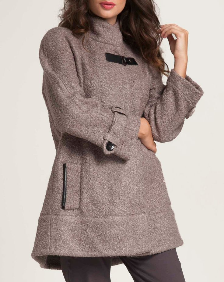"""Coat boucle made of a blend of wool in 'A"""" line. Right collar and three button fastening at front. Side slit pockets and seam at front and back edging. Decorative flaps at sleeves. Double pleat and flap with button at center back. http://www.alexanderjacob.com/en/coutes/145-boucle-coat.html"""