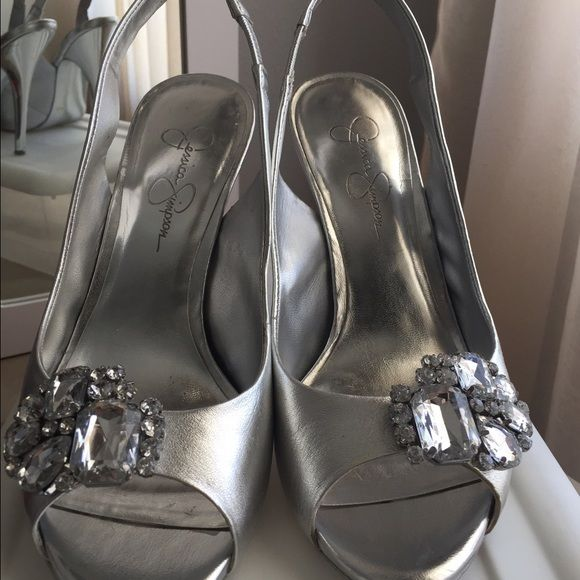 Jessica Simpson silver evening shoes Size 8.... 4 inch heel. Silver evening shoes with bejeweled brosh, peep toe, sling back. Don't have the original box, but will ship in the plastic shoe box I use for storing. Worn 2 times. Minor scratches. Jessica Simpson Shoes
