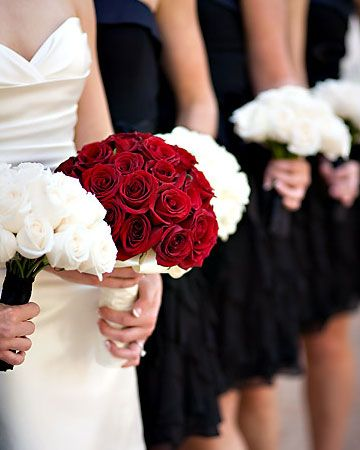 Red Wedding Bouquet mixed with white bouquets for the bridesmaids. Lets the bride really stand out