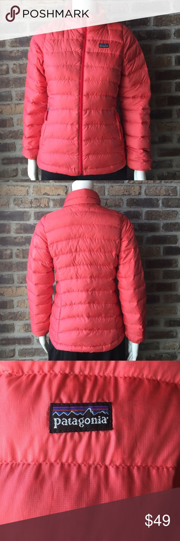 Girls Patagonia jacket Girls size large (12) Patagonia goose down jacket. Notice and picture you can see the dark feathers through the material it is not dirty. The jacket is on a size 6 manikin Patagonia Jackets & Coats Puffers