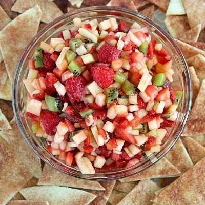 Fruit Salsa With Baked Cinnamon Chips  (this Was So Good, And I Left The Sugar Out Of The Salsa.)  2 Kiwis, Peeled And Diced  2 Golden Delicious Apples - Peeled, Cored And Diced  8 Ounces Raspberries  1 (16 Oz) Carton Of Strawberries, Diced  2 Tablespoons White Sugar (more Or Less To Taste)  1 Tablespoon Brown Sugar (more Or Less To Taste)  3 Tablespoons Fruit Preserves, Any Flavor (i Used Strawberry)    10 (10 Inch) Flour Tortillas  Melted Butter Or Butter Flavored Cooking Spray    Cinnamon…