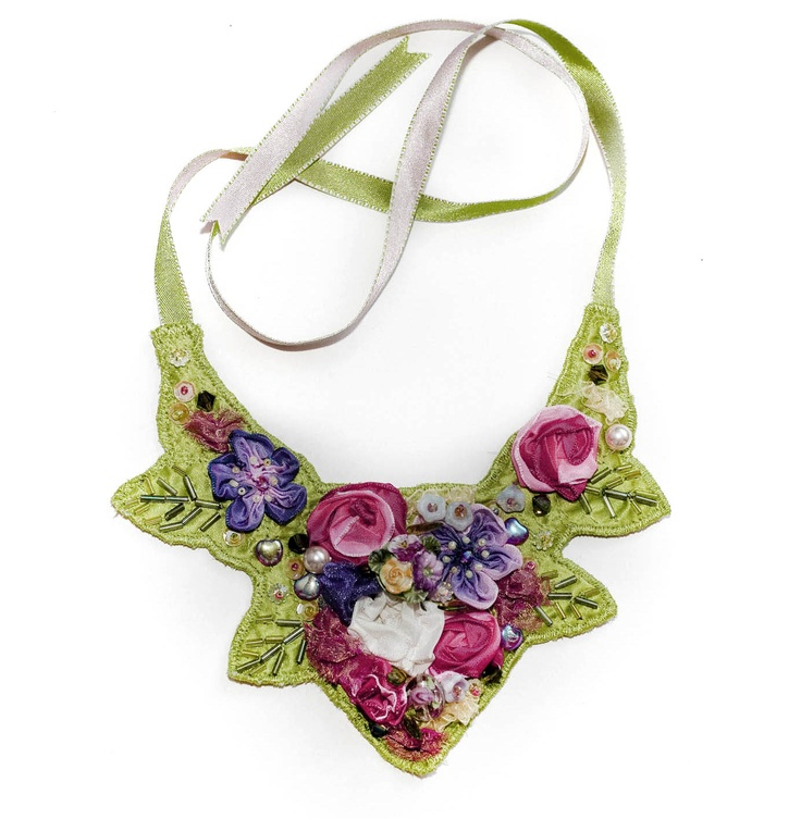 Jan Knibbs hand embellished necklace at South West Designers This design looks as if felt could have been used to create the base of the garment. A mixture of embroidery and appliqué could have been used also.