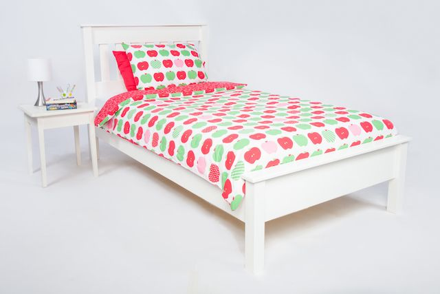 The Apples quilt cover by Cool Kids Rooms looks great on the white Ruthven bed.