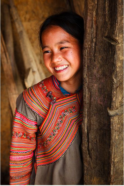 Smile for me!,  Flower H'mong hill tribe girl wearing traditional clothing, village between Coc Ly and Cao Son.