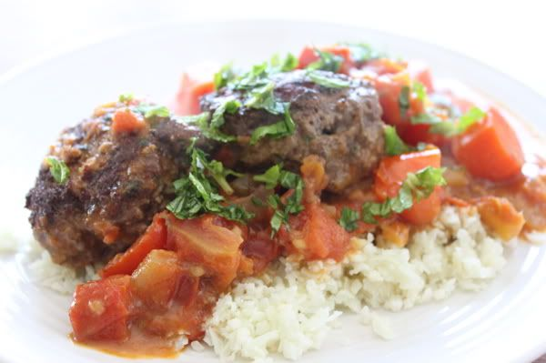 "... Meatballs in creamy Tomato-Curry Sauce on a bed of Cauliflower ""rice"