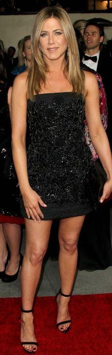 Jennifer Aniston:  Dress – Dolce & Gabbana    Shoes – Celine    Purse – Salvatore Ferragamo