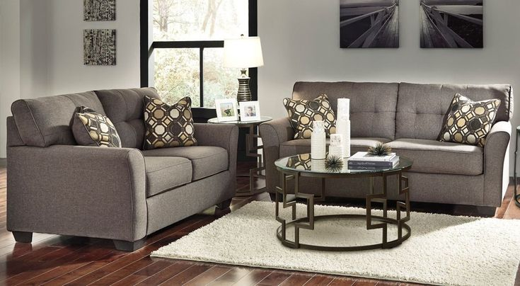 "The Alyssa upholstery collection has a contemporary design that will bring style to any living room. Its tufted cushion brings a flair to the line while the neutral color makes it easy to pair with any accent piece. DIMENSIONS Sofa 84"" W x 38"" D x 36"" H Loveseat 61"" W x 38"" D x 36"" H"