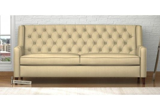 Shop Arlen 3 Seater Fabric Sofa Online India in Irish Cream. The 3 seater sofa fills the space making it appealing and guest ready. The three seater sofa designs with classic appearance goes well with the subtle decor of the living area. Buy sofa 3 seater online from the huge collection at Wooden Street from #Bhopal #NewDelhi #Ahmedabad
