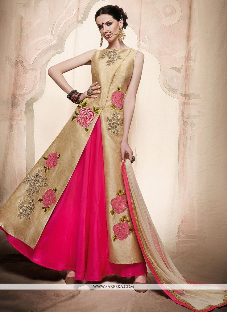 Bring out the true diva in you and reinvent your true self. Be an angel and create a smashing impact on everyone by wearing this cream and pink art silk long choli lehenga. The ethnic embroidered, res...