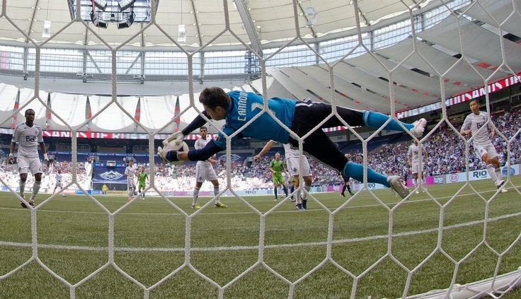 VANCOUVER, CANADA - MAY 19: Goalkeeper Joe Cannon #1 of the Vancouver Whitecaps makes a diving save against the Seattle Sounders during the second half of MLS Soccer actions on May 19, 2012 at B.C. Place in Vancouver, British Columbia, Canada.