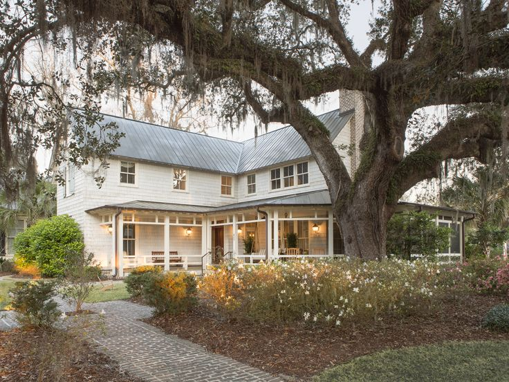 Southern style farmhouse with big oak tree and spanish moss Rebecca Gardner interior design