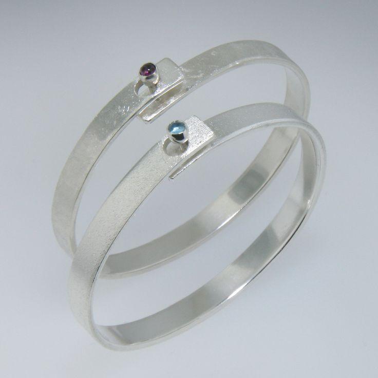Sterling Silver Handmade Bangle Bracelet for Men or Women with Garnet Clasp. $125.00, via Etsy.