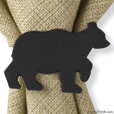 I cut out tiny bears from wood glued them to wooden napkin rings painted them all matte black I now have my own bear napkins rings for next to nothing CHEAP&EASY