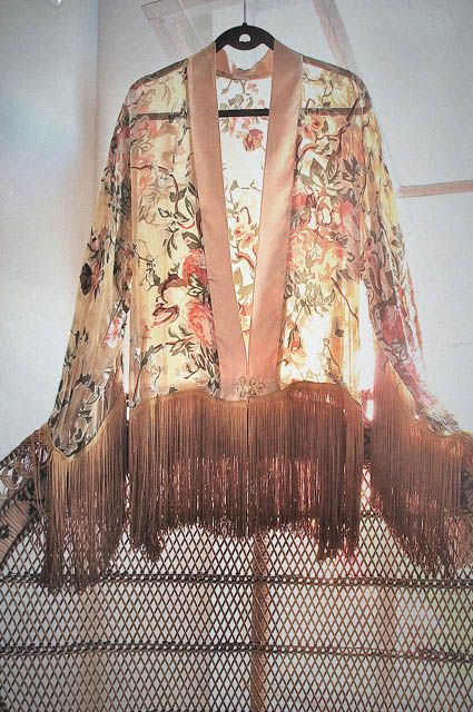 In the 70's, hippies were inspired by eastern cultures, in music, philosophies and fashion. The kimono is a traditional Japanese T-shaped robe, and became very popular. People wore them as home style robes and comfort wear, but also as glamour dressing.