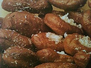 Recipe for traditional Cape Malay koeksisters (doughnuts) rolled in coconut.