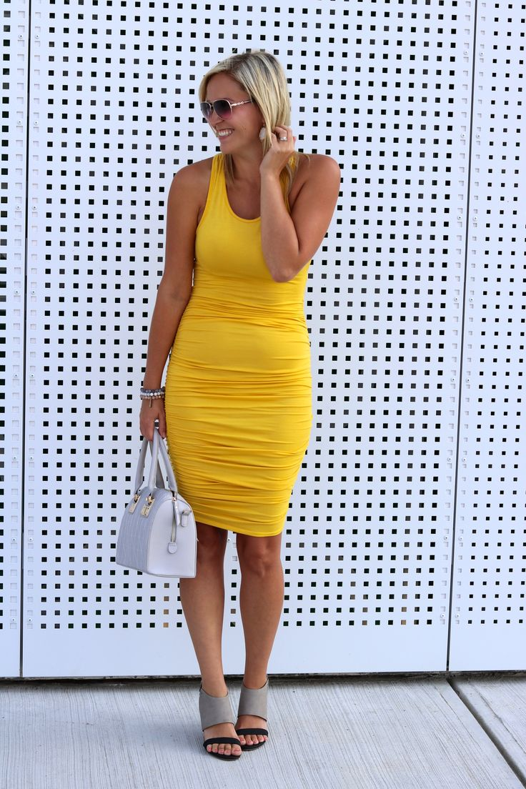 Love this gorgeous yellow racer back dress paired with the grey tote!