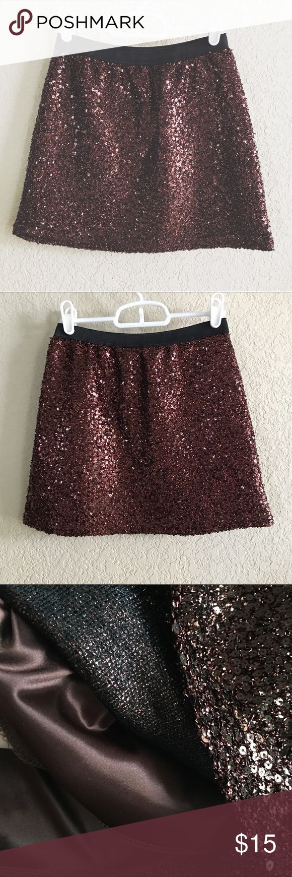 Copper sequin glitter mini skirt cute Cute copper mini sequin/glitter skirt. Purchased from a Korean clothing site labeled as one size. It has an elastic waistband but would best fit a size xs-s. It has a silky underskirt but it can still be a little itchy at times. Nothing unbearable or anything though! Color is a little hard to capture in a picture but it's a dark copper color. Skirts Mini