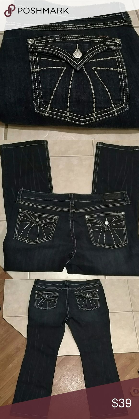 Seven jeans plus size Sale.  1 hr Perfect pair of plus size 22 jeans in like new condition. Beautiful back pockets with beautiful white threading throughout. Inseam is 31 inches with a rise of 11 inches. Waist flat measures 22 inches. These are the luxe version. 99% cotton 1% Spandex Seven7 Jeans Boot Cut