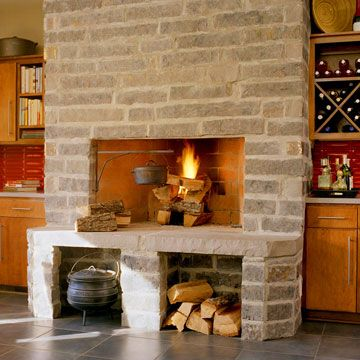 storage beneath the fireplace, and a little crane thingy to cook over the fire indoors - fun!