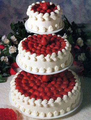 3 Tier Cheesecake Wedding Cake with Fresh Strawberries on Top and Whipped Cream
