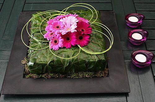 Bladapplicatie als mooi bloemstuk met bladeren van klimop voor in de huiskamer